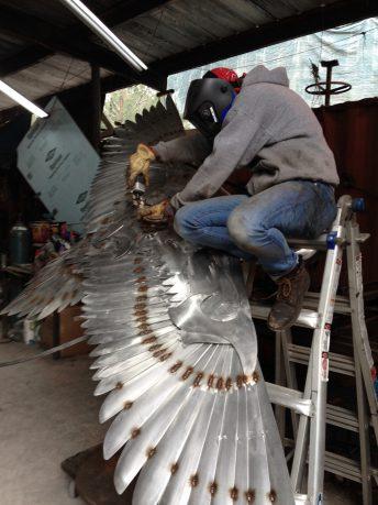 crane metal sculpture florida artist doug hays