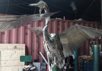 metal crane sculpture