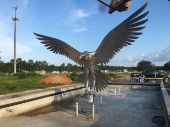 osprey sculpture with fish